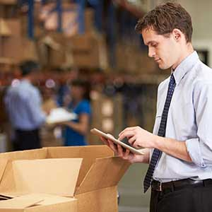 man with tablet in warehouse